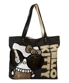 This denim Hello Kitty tote is snazzy fun for everyday wear. An inner zip pocket, leopard print Hello Kitty lining and faux patent leather detailing make this bag beautiful on the inside and out. Hello Kitty Handbags, Hello Kitty Purse, Hello Kitty Items, Sanrio Hello Kitty, Cat Purse, Punk Rock, Leopard Tote, Hello Kitty Collection, Black White Gold