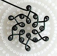 Step 13 to instructions for making a 3 Round Jewelry Wire Necklace by shaping jewelry wire on WigJig jewelry tools.