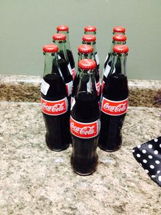 Grease sock hop 50's themed birthday party. Coca cola glass bottles.