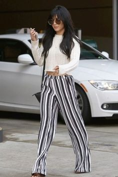 Vanessa Hudgens wearing the Row Round-Frame Acetate and Metal Sunglasses and Ella Moss Striped Pants