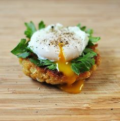 A perfect healthy egg recipe to start your day!  Quinoa cake with poached egg and parsley.