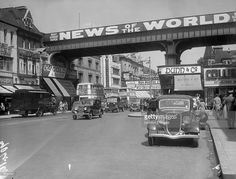 Traffic in Brixton High Street, south London, spanned by a railway bridge on which the newspaper News of the World is prominently advertised. Get premium, high resolution news photos at Getty Images Vintage London, Old London, South London, London Life, Cycling In London, London History, London Places, Old Street, London Calling