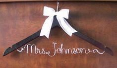 Custom dress hanger. They would be cute for all the bridesmaids too!
