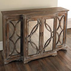"""Rustic Mirror Front Sideboard A beautiful weathered finish combines with classic design and tasteful mirror adornment in this rustic sideboard. Black painted interior. Side doors open to reveal a fixed center shelf and 2 center doors open to a fixed center shelf. (33.75""""Hx52""""Wx17""""D)"""