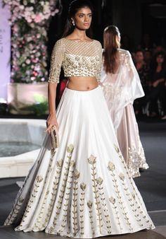 Get yourself dressed up with the latest lehenga designs online. Explore the collection that HappyShappy have. Select your favourite from the wide range of lehenga designs Designer Bridal Lehenga, Bridal Lehenga Choli, Manish Malhotra Bridal, Silk Lehenga, Manish Malhotra Anarkali, Lehenga White, Lehenga Designs, Indian Wedding Outfits, Indian Outfits