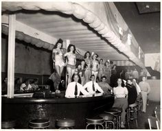 It's the weekend and burlesque girls are ready to spin their tassels for you at the 'Mardi Gras Club' on Duval Street.. (ca. 1950's)    (State University Libraries of Florida Collection)