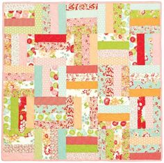 FREE baby quilt pattern! The Rail Fence 2 is colorful, bright and fun. It's also a great one for someone who wants to try quilting on for size.