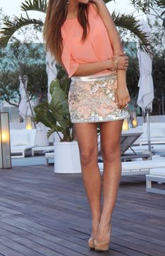 the coral top and the shimmery skirt