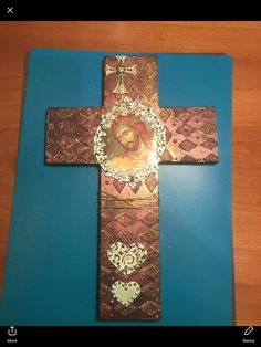 Mixed media cross on wood 40cm x 40cm. Saréka Manis design