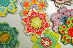 Paper Pieced Hexies with  Fussy Cutting by xoxoamitie.girl, via Flickr