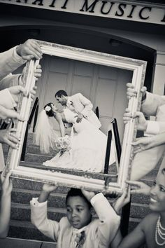 picture frame.bride & groom.wedding guests.