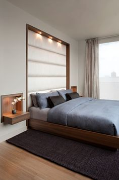 A custom headboard and side tables are inset into wall, framed in a specially treated smoked oak, and lined in eight-ply Thai silk.