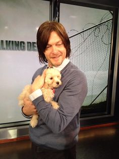 Norman Reedus and puppy...that is awesome..he needs to bring it on the show. See what ensues