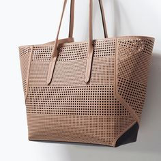 What's better than a shopper bag that is both stylish and functional? Nothing! Fit all your essentials and goodies in this chic perforated tote