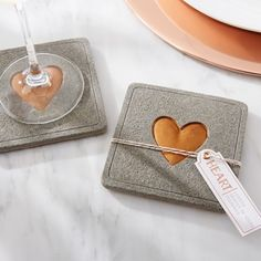 We love these concrete and copper heart coasters from Kate Aspen