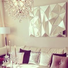 I love faceted mirrors! Makes a stunning statement in living room or dining room. Makes a change from the usual plain mirrors. | bocadolobo.com/ #livingroomideas #livingroomdecor