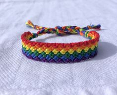 I hand knotted this friendship bracelet using red, orange, yellow, green, blue and purple cotton string. It will fit wrist size 5 6 or 6 inches. Diy Rainbow Friendship Bracelets, Friendship Bracelet Patterns, Cotton String, Bracelet Knots, Blue Chevron, Boho Hippie, Fancy, Purple, Handmade