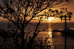 Sunrise over Llandudno pier. North wales UK. by ccrcats. If you like you can buy it at http://fineartamerica.com/featured/sunrise-over-llandudno-pier-christopher-rowlands.html?newartwork=true