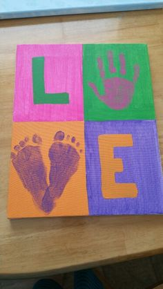 """Today's pinterest inspired project! """"Love"""" canvas with my oldest daughter's handprint and baby girl's footprints ♡"""
