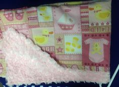 baby pink squares with pink rose on the back small blanket for travel or in the stroller.
