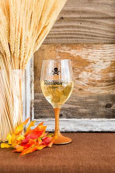 "Happy Hallowine! Get in the Halloween spirit with this adorable wine glass! Pair with our additional Halloween & Harvest items for a complete look. <br />  <br />  - Material: Glass<br />  - Sparkly orange stem<br />  - 8.25"" height<br />  - Imported"