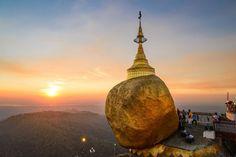 The Golden Rock sits precariously on the edge of Kyaiktiyo Mountain in Myanmar