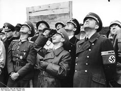 Albert Speer (right) Josef Goebbels (next to Speer) and senior military and Nazi party officers attend the test of new aircraft, Aug 1943. By 1943, Speer, in his capacity as armaments minister, was accelerating weapons production at speeds remarkable for wartime. By the end of the war, German arms production was HIGHER in most sectors than in earlier phases of the conflict.