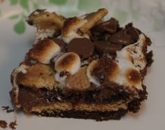 Have a taste of the camping life without the camping with some gooey and mouth watering s'mores brownies!