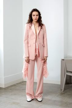 Suit softened by draping lace layer by Altuzarra for Resort 2018 collection.