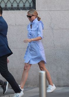 Dressed to impress: Gwyneth Paltrow, 44, looked as though she didn't have a care in the world while sauntering through the streets of Milan on Monday