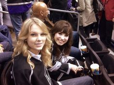 Recording artists Taylor Swift and Demi Lovato attend the NHL game between the Tampa Bay Lightning and the Los Angeles Kings on January 12 2009 at...