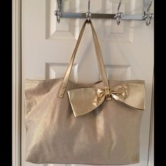 Lilly Pulitzer Oh Cabaña Boy Gold Tote Bag Leather trim.  Snap closure.  3 interior pockets (1 zips).  Like new. Large.  Measures: 16.5x5x12.75x9.5. Lilly Pulitzer Bags Totes