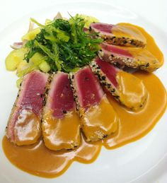 Seared Yellow Fin Tuna with Seaweed Salad, Cucumber and Red Onion and Citrus-Ginger Dressing.