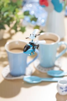 The world's smallest remote-controlled helicopter is impossibly cute