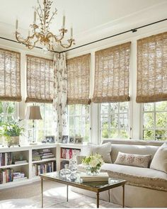 I love the matchstick roller blinds here.  They let in filtered light and add texture and a natural material.