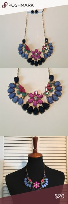 Beautiful necklace and earring set! New with tags, $30.00, gorgeous stone necklace and earring set. Earrings are navy blue and necklace is blue, purple, pink, and navy. Color Jewelry Necklaces