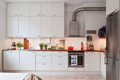 Love everything about this! White kitchen, wood bench top, exposed pipe. So much storage!!