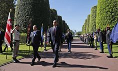 Barack Obama and French President Francois Hollande arrive at the Normandy American Cemetery