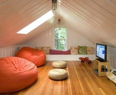 the attic that was originally going to be a teen bedroom was rehabbed as a place to hang out with friends most of the pillows are from homegoods