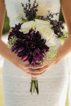Fall Wedding Bouquet | Mixture of silk (everything deep purple) and real (roses and baby's breathe) flowers with a feather for fun.