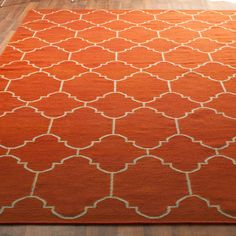 Moroccan Tile Dhurrie Rug: 4 Colors...too bad it's $1000. If anyone finds one that's less expensive, let me know!