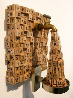 Spew by Ron Ulicny: It's a scrabble sculpture! That might be the most unique use of scrabble tiles I've ever seen. Love this kind of art. Inspires me to use the most common and/or unusual materials to make art. Scrabble Kunst, Scrabble Art, Scrabble Tiles, Art Public, Found Object Art, Assemblage Art, Home And Deco, Installation Art, Oeuvre D'art