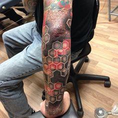 Awesome geometrical pattern and honeycomb dot work tattoo sleeve @coryferguson | Webstagram