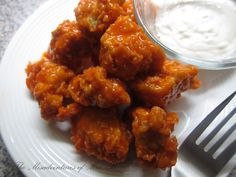 Sometimes I take popcorn chicken and coat it in buffalo sauce.  And I am very, very happy when I do.