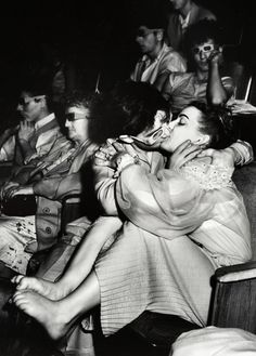 Lovers with 3-D Glasses at the Palace Theater, 1943. Photograph by Arthur (Weegee) Fellig
