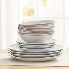 Features:  -Exclusively.  -Set includes 4 dinner plates, 4 salad plates and 4 bowls.  Style (Old): -Contemporary.  Material: -Porcelain China.  Number of Items Included: -12.  Set Includes: -4 Dinner