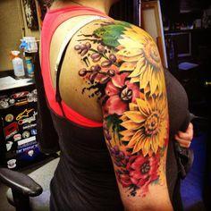 Beautiful bouquet half sleeve tattoo
