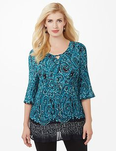 Perfectly pleated, our sheer blouse gracefully flows over your figure for a flattering fit. The vibrant paisley pattern is complimented by the sparkling rhinestones at the keyhole neckline. Contrast coloring draws attention to the three-quarter sleeves and hem. V-neckline. Catherines tops are designed for the plus size woman to guarantee a flattering fit. catherines.com