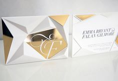 3D-printed invitation featuring geometric facets and gold chrome finishes. A slot in the top of the piece allows an invitation card to slip inside and be visible from the reverse side. Wedding invitation inspiration