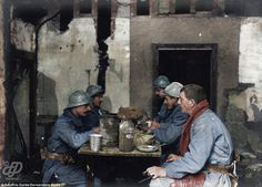 French soldiers eat soup at a police station in Neuvilly on December 7, 1915. Their blue-g...